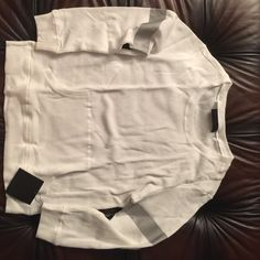 """Norma Kamali long sleeve thermal white sweat tee Brand new with tag and original packaging long sleeve cotton blend boyfriend swear tee silver lines on the sleeves size M but fits very loose oversized top to bottom 28"""" shoulders 18"""" crew neck Norma Kamali Tops Tees - Long Sleeve"""
