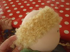 KNITTED (rather than crocheted) Waldorf doll wig tutorial from Nestled Under Rainbows.