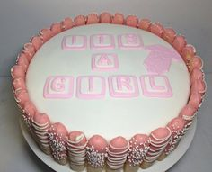 Baby shower cake. Chocolate dipped lady fingers with fondant baby blocks