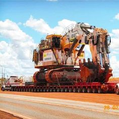 Liebherr shovel dwarfs a semi & heavy load wagon.