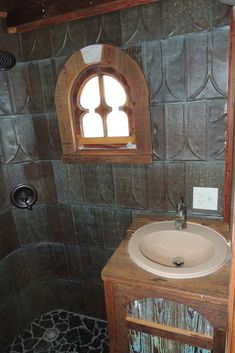 Arched Brownine (Arched Brownie) from Tiny Texas Houses - Salvage - Metal roofing shingles from the early adorn the walls of the shower and are sure to last another hundred years or more. Tiny House Plans, House Floor Plans, Tiny Texas Houses, Desk In Living Room, Tin Tiles, Tiny House Living, Wet Rooms, Ceiling Decor, Home Photo
