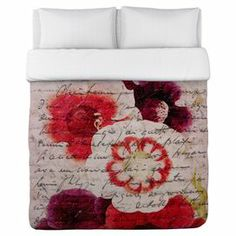 "The perfect accent for your master suite or guest room decor, this eye-catching duvet showcases a lovely floral motif and typographic details. Made in the USA.   Product: Duvet coverConstruction Material: PolyesterColor: Red and multiFeatures:  Floral motifTypographic accentsMade in the USA Dimensions: Twin: 68"" x 88""Full/Queen: 88"" x 88""King: 104"" x 88""Note: Pillows and sheets not included"