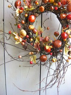wreath...bright and I love the woodsy part of it:)
