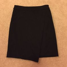 FLASH SALE ✨ Vera Wang Bandage skirt business professional! this skirt is super cute and skin-tight, but still professional. it reaches to just above the knee. there's a small slit in the front and little pleats that are hard to see in pictures. worn once! tag says xs but probably fits best on a s-m Vera Wang Skirts Asymmetrical