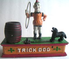 Vintage Reproduction Cast Iron Coin Bank Trick Dog by QVintage, $40.00