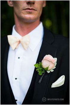 pink boutonniere and a peach tie