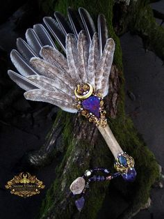 GOLDEN OAKWING. Turkey Feather Smudge Fan. Peacock Ore, Amethyst, Labradorite. Ice Age Bison Metacarpal fossil handle. Amethyst Quartz cluster and Druzy Quartz beaded dangles. Lovingly handmade in The Secret Lair by Susan Tooker