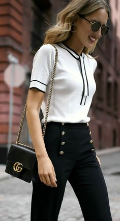 White tie neck knit top with black piping, navy sailor inspired button front pants, black ankle strap block heel sandals + classic leather crossbody bag {Gucci, St. John, Tahari, Steve Madden; statement pants, creative office style, workwear, wear to work