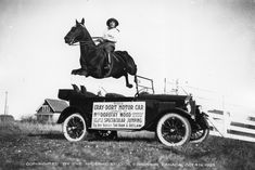 1920s - Technology. Miss Dorothy Wood and her horse jumping over a Gray-Dort car.