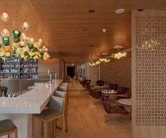 bosk, which means 'small wooded area', is enveloped in a family of oak wood panels and screens used to define areas and allow for flexibility in the dining arrangements-HKCC
