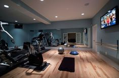 A home gym can be a great convenience. However, coming up with the perfect home gym design to suit personal preferences can be a challenge. The best home gym design increases the chance of achievin… Home Gym Decor, Gym Room At Home, Home Gym Mirrors, Modern Family Rooms, Dance Rooms, Basement Gym, Basement Walls, Basement Ideas, Garage Ideas