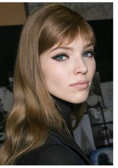 """happy"" or ""smiling"" bangs ... corners of the lengths of the sides are cut upwards to elongate eye"