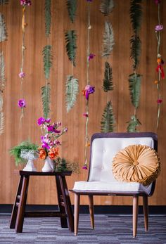 hanging flower backdrop - photo by Barrie Anne Photography http://ruffledblog.com/mid-century-modern-spring-elopement #backdrops #weddingideas #diy