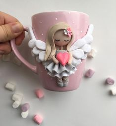 No photo description available. Polymer Clay Cat, Polymer Clay Projects, Polymer Clay Creations, Handmade Polymer Clay, Clay Crafts, Clay Jar, Clay Mugs, Coffee Cup Crafts, Clay Magnets
