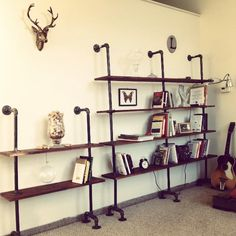 My new bronzed deer head and handmade pipe bookshelf #diy #pipeart