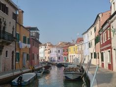 Just like the sailors of old, you'd recognize this Venetian island by the picturesque pastel-colored houses and buildings visible from its shores. Burano also is famous for its intimate lace, an art its people want to keep alive.