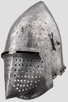 An Italian bascinet, early 15th c One-piece skull rising to a point at the rear, the edge pierced for a lining and studded with brass vervelles for attaching an aventail, fitted with pivoted hinges at the sides, the visor associated and reworked. Height 27 cm. Weight 2285 g. the visor Weight 740 g. Extremely rare early type of helmet, private collection