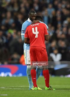 Kolo Toure of Liverpool embraces his brother Yaya Tour of Manchester City during the Capital One Cup Final match between Liverpool and Manchester City at Wembley Stadium on February 28, 2016 in London, England.