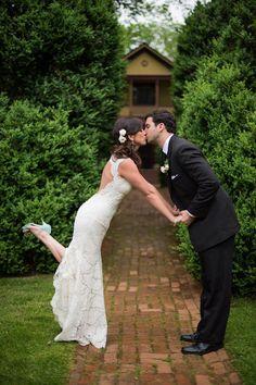 a kiss so good, it's deserving of a leg kick  Photography by cramerphoto.com