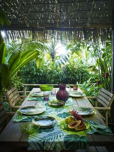 Update your table, with the John Lewis La Selva range. Mix textured coloured glass and bold palm prints to create a distinctive tropical table perfect for al fresco parties.
