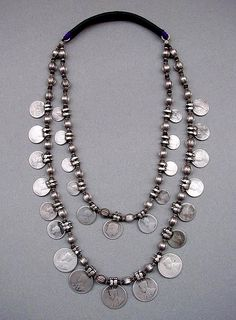 A two strand necklace from North India.The die-stamped pod-shaped beads have small wooden buffer beads in between to protect them from rubbing against each other. Coin Jewelry, Tribal Jewelry, Bohemian Jewelry, Beaded Jewelry, Silver Jewelry, Jewelry Necklaces, Silver Rings, Diy Collier, Look Boho