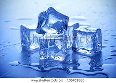 wet ice cubes on blue background - stock photo