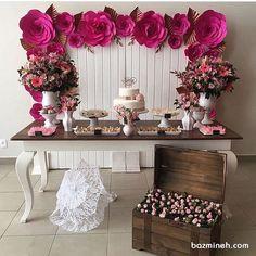 دکوراسیون ساده و شیک جشن تولد دخترونه تزئین شده با گل های زیبای کاغذی سرخابی