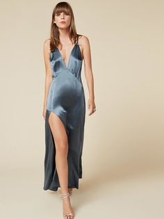 Oh hey, I didn't see you there. This is an ankle length dress with a high slit and adjustable, cross-back straps.