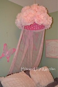 make your own canopy with tissue paper pom poms, fabric and a laundry basket!