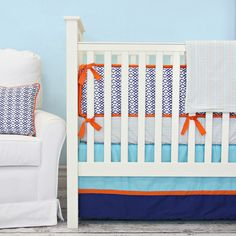 Aqua and Navy is a great color combo for any baby boy nursery, and we love the aded pop of orange! #PNshop