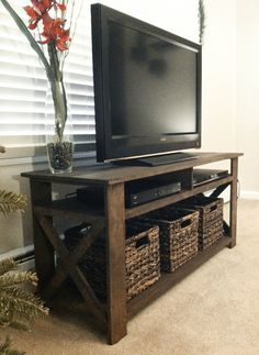 Love the simplicity and wood on this tv stand.