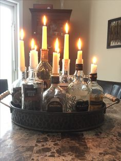 Perfect way to repurpose old liquor bottles for under 10$. Vintage and classy look as a centrepiece, patio, or man cave.