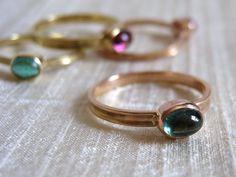 Green Tourmaline Stacking 18k Pink Gold Skinny Ring. FavreBijoux via Etsy.