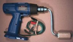 Convert a battery powered drill into a hand crank battery charger (without harming the drill)