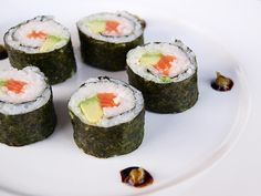 "Sushi is easy! Jasmine Rice, Nori (seaweed sheets) Rice Vinegar, and sugar. Now you need filler. Imitation Crab, avocado, cream cheese and cucumber are great! Once you get the hang you can use ANYTHING (Only use ready-to eat meats) Heat vinegar and sugar at a 3:1 ratio. Sprinkle on cooked rice while fanning, taste, should have a light sweet bitter taste. Put in fridge. Cut your ""fillers"" into strips. Pressing rice on nori (shiny side down). Add filler and roll up! Cut with a SHARP kinfe <3…"