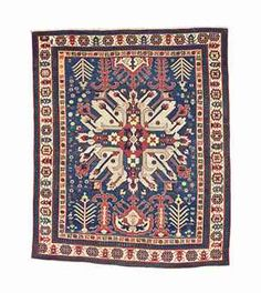A CHELABERD RUG -  SOUTH CAUCASUS, LATE 18TH/EARLY 19TH CENTURY -  Of 'sunburst' design, 6ft. x 4ft.10in. (183cm. x 147cm.)