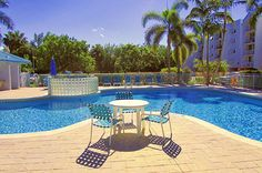 "Hang out at the pool area with a cold drink - Key West Top Floor Condo ""Seaside Breeze"" -Monthly -  - rentals"