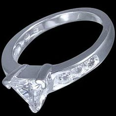 Silver ring, CZ, triangle Silver ring, Ag 925/1000 - sterling silver. With stones (CZ - cubic zirconia). Perfectly crafted ring, a distinctive triangle complemented by small round zircons on either side.