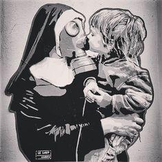 street art berlin @ oderbergerstr. - photo by ironwhy - artist @leloup_hamburg #christianlove #streetart #leloup #nun #mask #kiss #kissing #child #littleboy #love #church #christian #gasmask #donttouchme #distance #berlin #publicart #streetartistry #mural #grafittiart #graffiti #stencilart #stencil #ironwhy #prenzlauerberg #oderbergerstrasse