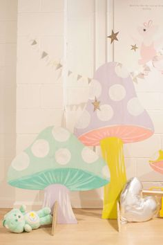 DIY plywood mushrooms for Alice in Wonderland party