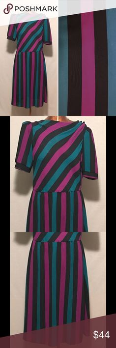 "1980s Black Striped Sheer Dress CHEST SIZE: 34"" WAIST SIZE: 32"" HIP SIZE: 38"" SHOULDER TO SHOULDER: 16"" SHOULDER TO HEM: 40"" WAIST TO HEM: 24""  MATERIAL: polyester  TAGS: Oops California  There are a couple of small spots on the fabric. One is on the front shoulder close to the seam, and the other is on the front of the Skirt midway down. These spots are very small and in no way detract from the beauty of this dress. Please note that this dress is shear and will require a full slip…"