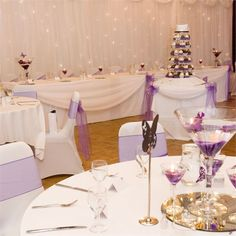 <p>Ellen and Tim hired the help of Nicola from Perfect Finish to help decorate the wedding venue. She provided the chair covers, sashes, twinkle back drop and table centerpieces which looked truly magnificent against the white back ground. The centerpieces consisted of large martini glasses filled with purple crystals, flowers and floating candles. Butterflies were then added for an extra touch.</p> <p>Instead of wedding favours, Ellen and Tim decided to create a candy buffet whi...