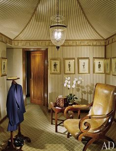 """ceiling    """"If English country house is your look, it doesn't matter if you have it in England or in New York or in the tropics,"""" said Mario Buatta. Reinforcing that idea, the designer brought a decidedly European sensibility to a residence in the Philippines. The tented dressing room, with its striped walls displaying vintage Vanity Fair portraits, has an intimate, old-world feel.  (August 2006)"""