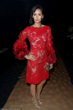 Fashion savvy: The actress, 27, stunned in a knee length red lace and ruffled…