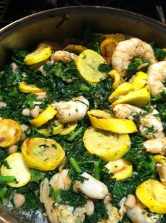 Grilled Jumbo shrimp: marinated in garlic, olive oil, lemon, fresh basil and fresh parsley.. Grilled yellow squash, organic canellini beans, sautéed kale in olive oil and crushed garlic, red pepper flakes and lemon... Mixed in quinoa.