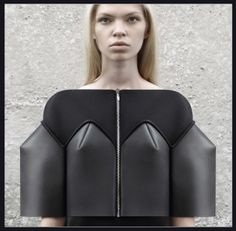 DZHUS conceptual wear brand was founded in 2010 by a young Ukrainian designer Irina Dzhus. The brand's design concept is based on interaction and transformation of construction modules in order to create new aesthetics of the form – avant-garde and virtually archetypical at the same time, categoric but variable