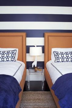navy striped wall and orange headboard