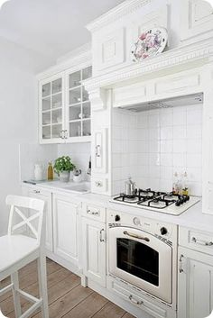 forget stainless, I love white kitchens