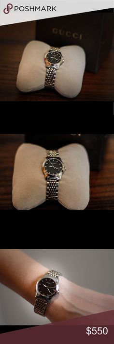 Gucci G-timeless ladies watch This is in mint condition just had the battery changed. Stainless steal band the face is black and has a date on it... love this piece got so many compliments on it but no longer wear it after becoming a stay at home mom trying to sell to get some camera gear Gucci Jewelry