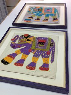 Indian pillows in purple frame.